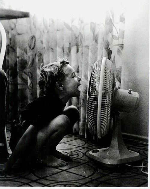 girl-talking-into-fan.jpg